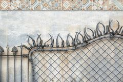 Forge fence and some hydraulic tile decoration on a Modernist styled architecture. Touristic building and empty copy space. For Editor`s text royalty free stock image