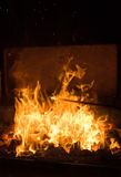 Forge fire. Forge in a blacksmith's crafting iron tools Stock Photos