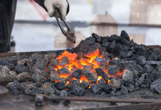 Forge fire in blacksmith's where iron tools Royalty Free Stock Photo