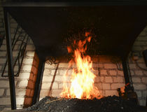 Forge fire in blacksmith's where iron tools are crafted Royalty Free Stock Images