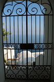 Forge gate. Villa at the sea, behind a delightful forged gate, Italy Royalty Free Stock Photos