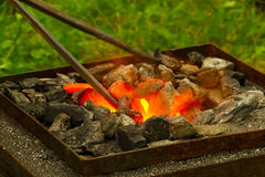 Forge. Image of glowing coals to heat the metal to its forging royalty free stock image