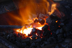 Forge with iron stick. Forge with hot iron stick stock photography