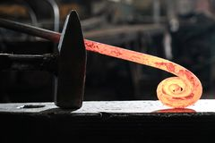Forge, production workshop. Blacksmith tools and hot metal. The concept of manufacturing royalty free stock photo