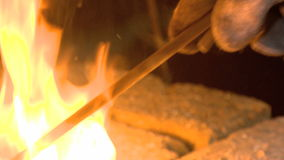 Forge, rose, flower, to make red hot. A blacksmith forges from a metal work of art stock video footage