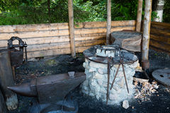 Forge in russian style in a village in Russia Stock Images