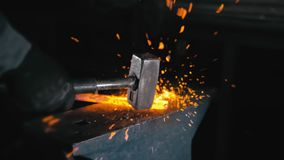 Free Forge Workshop. Smithy Manual Production. Hands Of Smith With Hammer Hit On Glowing Hot Metal, On The Anvil, The Forging Stock Photos - 160301013