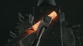 Forge workshop. Smithy manual production. Hands of smith with hammer hit on glowing hot metal, on the anvil, the forging stock video