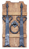 Forged. Antique forged hinge and ring on the wooden board Royalty Free Stock Photography