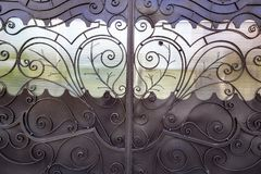 Decorative, forged barrier, fence in old stiletto Stock Image