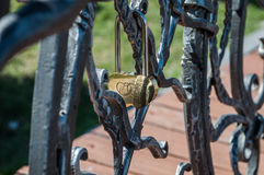 Forged bird on the bench. Forged bird with raised wings on a bench Royalty Free Stock Photos