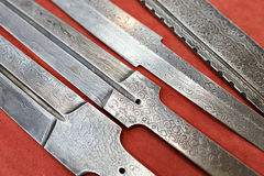 Forged blanks for medieval swords on red Stock Image
