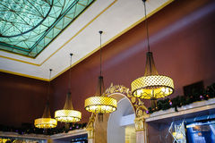 Forged chandeliers in the restaurant.  Royalty Free Stock Images