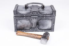 Forged chest with a hammer Stock Photo