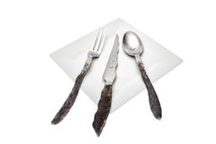 Forged cutlery. Unconventional cutlery harmonizing with the simplicity of the dish Royalty Free Stock Photography