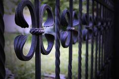 Forged decorative metal fences. Elements of a metal fence.  stock image