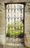 Forged entrance gate in castle ruins Royalty Free Stock Image