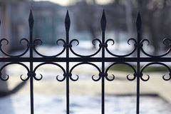 Forged fence Stock Images