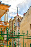 Forged fence near the old house with columns Stock Photo