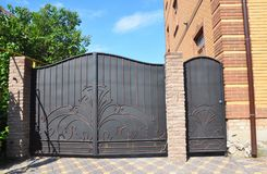 Forged gate and house metal door. Metal Gates - Gates. & Metal Railings stock images