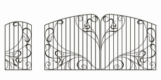 Forged gate, wicket and fence Stock Photo