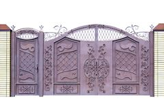 Forged gates and door for building by ornament. Royalty Free Stock Photography