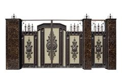 Forged gates and door with decor. Royalty Free Stock Photos