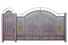 Forged gates and door by ornament. Forged  decorative  gates  decorated by ornament. Isolated over white background Royalty Free Stock Image
