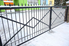 Forged gates at winter time Stock Images