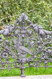 Forged grid of the Park in Warsaw. Forged grid (wrought-iron fence) of the Park in Warsaw royalty free stock photos
