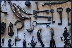 Forged handmade knives and other objects. Stock Photo