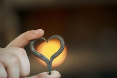 The forged heart in hands. The forged heart against the background of fire Stock Images