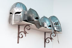 Forged helmets. Of medieval knights Royalty Free Stock Photos