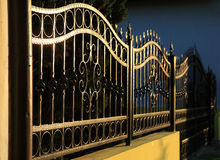 Forged iron fence. Forged decorative iron fence at sunset Stock Photography