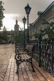 Forged lanterns, antique benches, decoration of Kiev Pechersk Lavra royalty free stock photo