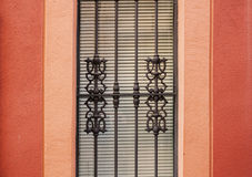 Forged lattice on a red wall Stock Photography