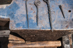Forged medieval metalware on an anvil Stock Photo