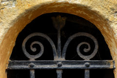 Forged metal lattice on cellar window Royalty Free Stock Image