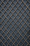 Forged metal lattice on gray background Royalty Free Stock Photo