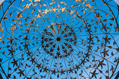 Forged metal pattern on the blue background Stock Image