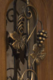 Forged metal pattern on the door. Forged metal pattern on the wooden door Stock Image