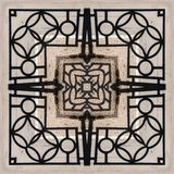 Forged openwork iron fence - a pattern square from a photo royalty free stock image