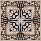 Forged openwork iron fence - a pattern square from a photo stock image