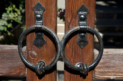 Forged rings on the doors Stock Photo