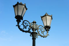Forged street lamp. Royalty Free Stock Photo