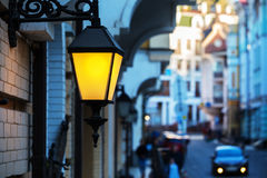 The forged street lamp is shining Royalty Free Stock Photos