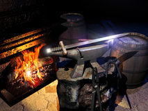 Forged sword. Close view to  the workroom of a smith, with his tools near the fire, and a sword on the anvil Stock Photography