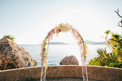Forged wedding arch. Wedding on the sea at sunset, Montenegro, P. Rzno city Royalty Free Stock Photography