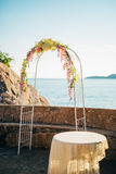 Forged wedding arch. Wedding on the sea at sunset, Montenegro, P Royalty Free Stock Image