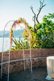 Forged wedding arch. Wedding on the sea at sunset, Montenegro, P Stock Image